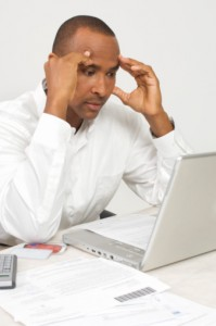 Man with a Laptop Figuring out Bills